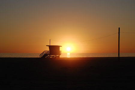 Lifeguard tower station at sunset  in Santa Monica beach, California