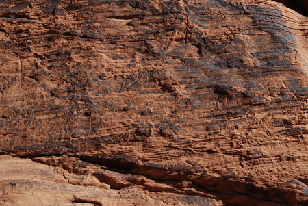 Wall of petroglyphs on red sandstone in the Valley of Fire, Nevada, USA