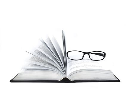 Opend book and glasses on a white background Imagens