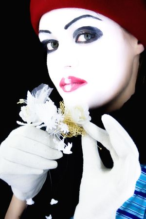 mime with a flower on a black background photo