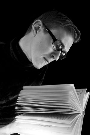 Portrait of the young man with the opened book Stock Photo - 3575049