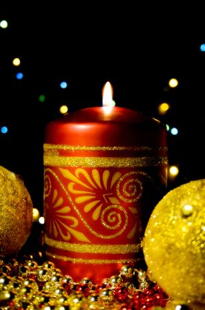 Christmas card with burning candles and Spheres photo