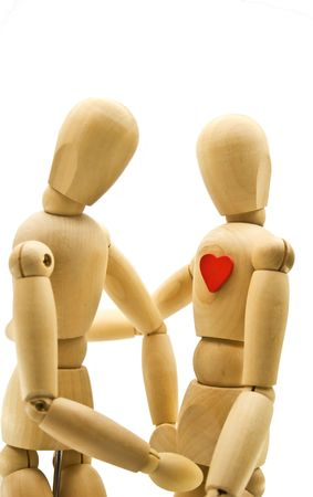 Loving couple of wooden dummies isolated on a white background photo