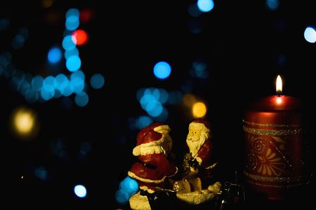Burning candle with Christmas-tree decorations photo