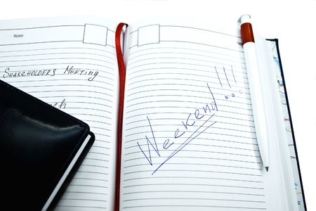Notebook and pencil isolated on a white background photo