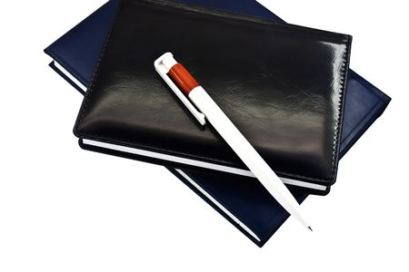 Notebook and the pencil isolated on a white background photo