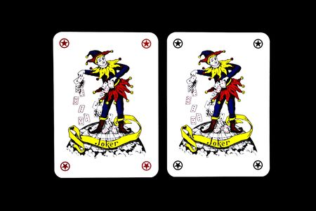 joker playing card: Playing cards on a black background