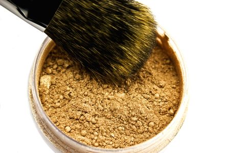 corporal: Powder and brush isolated on a white background