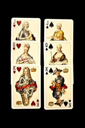 king and queen of hearts: Old playing cards on a black background