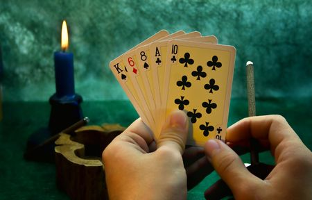 Playing cards in a hand photo