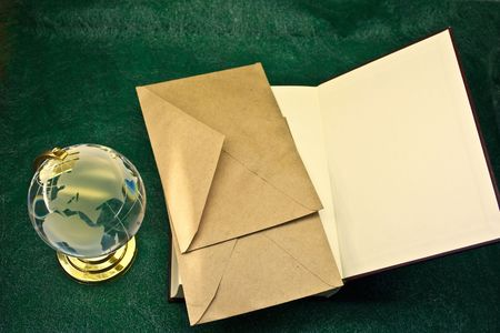 matte: glass globe and the old book Stock Photo