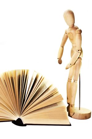 The open book and wooden dummy isolated on a white background photo