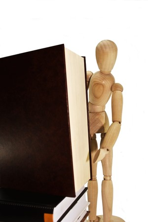 Wooden dummy with books on a white background photo