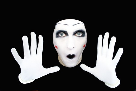 Portrait of the mime in white gloves on a black background
