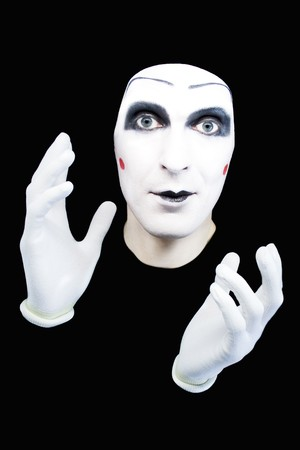 Portrait of the cheerful mime in white gloves on a black background photo