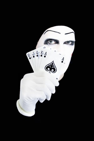 queen's theatre: Portrait of the mime with playing cards on a black background Editorial