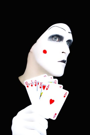 Portrait of the mime with playing cards on a black background photo
