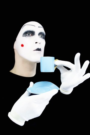 Portrait of the mime with a blue cup on a black background photo
