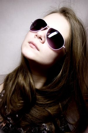 Portrait of the young woman in sunglasses Stock Photo - 4103199