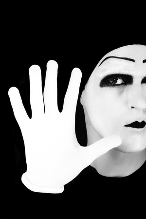Portrait of the mime in white gloves. Stop it. photo