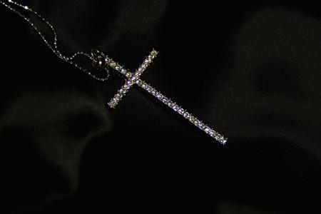 brilliants: Diamond cross on black silk Stock Photo