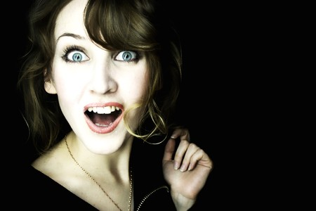 Portrait of the young surprised woman photo