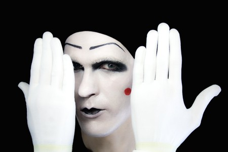gesticulation: Portrait of artful peeping mime in white gloves