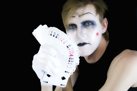 Portrait of the mime with a fan of playing cards photo