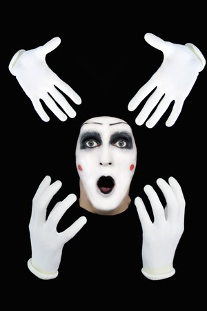 Portrait of the surprised mime on a black background photo