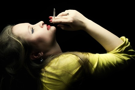 Portrait of beautiful young woman with a cigarette in a hand photo