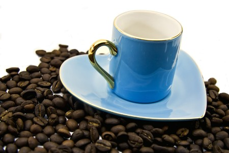 sheeny: Blue cup and saucer with grains of coffee