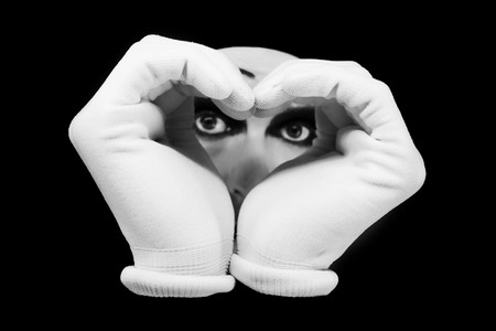 Heart and eyes of  mime on a black background Stock Photo