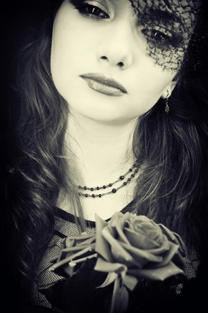 portrait of woman in the veil with  roses photo