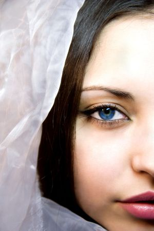 Portrait of the girl with dark blue eyes in a silk scarf photo