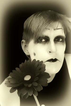 parody: gloomy mime with a red flower on a black background
