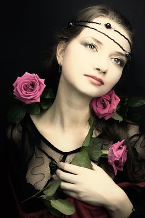 young woman with a rose. medieval style photo