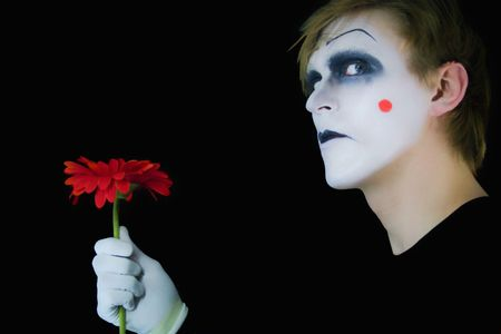 parody: gloomy mime with red flower on a black background
