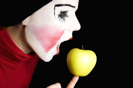 mime biting an apple Stock Photo - 4789275