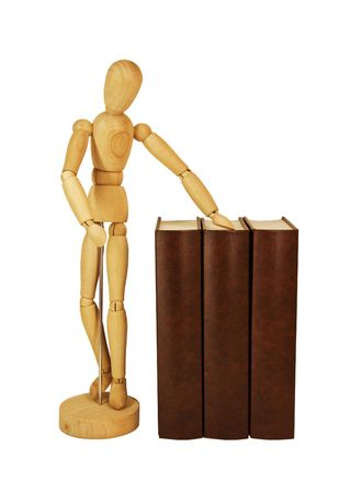 Wooden dummy and pile of old books isolated on a white background photo