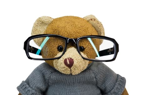 Teddy bear in glasses on a white background