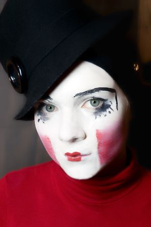 Portrait of sad mime in hat photo