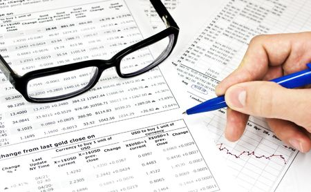 undersign: Glasses, financial documents and male hand with pencil