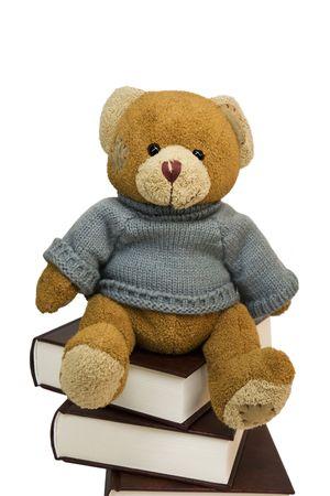 Teddy bear on pile of old books photo