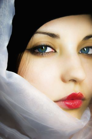 The beautiful girl in a scarf with blue eyes photo