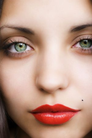 eye red: face of  young beautiful brunette close up Stock Photo