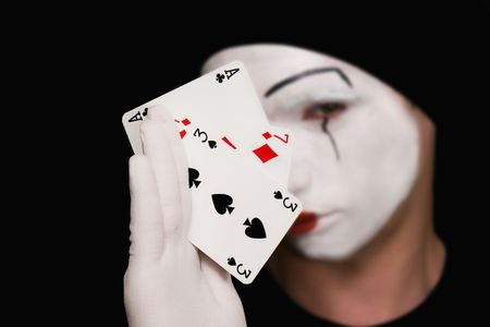 Portrait of  mime with playing cards on  black background photo