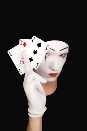 Portrait of  mime with playing cards on  black background Stock Photo - 5445656
