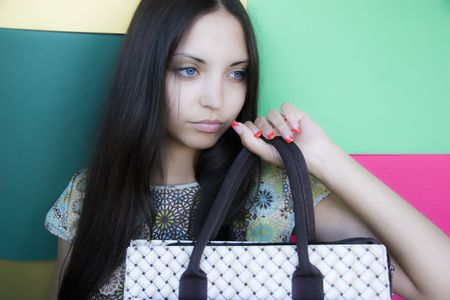 Young brunette having control over a bag photo