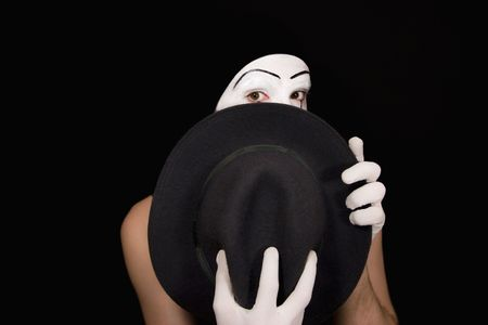 Surprise mime with a hat on a black background photo