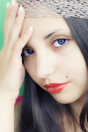 face of  young beautiful brunette photo